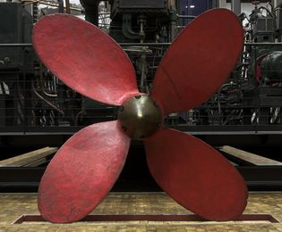 A large, red propeller.
